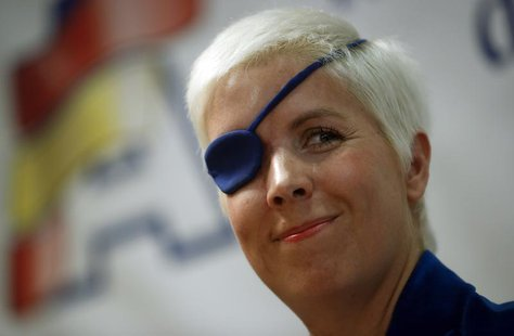 Marussia Formula One test driver Maria de Villota of Spain smiles during her news conference in Madrid October 11, 2012. REUTERS/Sergio Pere
