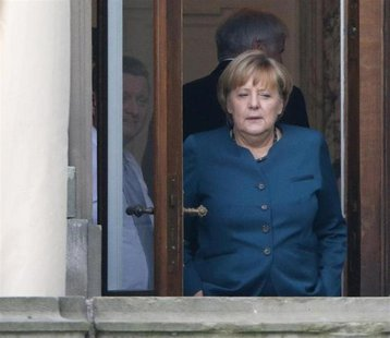 German Chancellor and leader of the Christian Democratic Union (CDU) Angela Merkel stands on a balcony while taking a break during prelimina