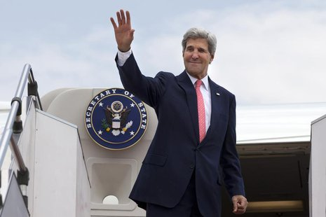 U.S. Secretary of State John Kerry waves as he leaves, after completing his trip to Malaysia, from Subang TUDM outside of Kuala Lumpur, Octo