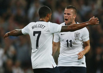 England's Theo Walcott (L) celebrates with team-mate Tom Cleverley after scoring against Scotland during their international friendly soccer
