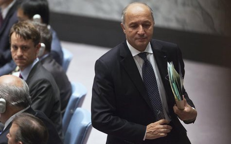 France's Minister of Foreign Affairs Laurent Fabius walks out during a Security Council meeting on small arms, during the 68th United Nation