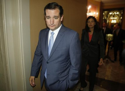 U.S. Senator Ted Cruz (R-TX) departs after a meeting with fellow Republican senators at the U.S. Capitol in Washington, September 30, 2013.