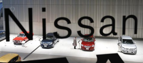 A man looks at a Nissan car at its showroom in Yokohama, south of Tokyo, December 18, 2012. REUTERS/Kim Kyung-Hoon