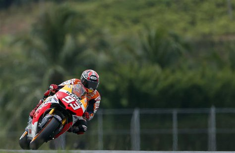 Honda Moto GP rider Marc Marquez of Spain takes a curve during the qualifying session of the Malaysian Motorcycle Grand Prix at Sepang circu