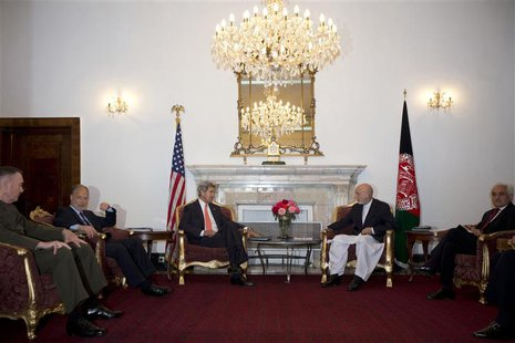 U.S. Secretary of State John Kerry (3rd L) meets with Afghan President Hamid Karzai, in Kabul October 11, 2013. REUTERS/Jacquelyn Martin/Poo