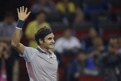 Roger Federer of Switzerland reacts after winning his men's singles tennis match against Andreas Seppi of Italy at the Shanghai Masters tenn