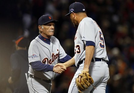 Oct 12, 2013; Boston, MA, USA; Detroit Tigers manager Jim Leyland congratulates pitcher Joaquin Benoit (53) after defeating the Boston Red S