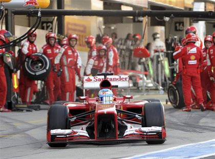 Ferrari Formula One driver Fernando Alonso of Spain leaves the pit during the Japanese F1 Grand Prix at the Suzuka circuit in Japan October