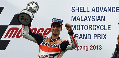 Honda MotoGP rider Dani Pedrosa of Spain celebrates after winning the Malaysian Motorcycle Grand Prix in Sepang October 13, 2013. REUTERS/Sa
