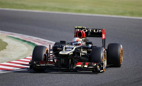 Lotus Formula One driver Romain Grosjean of France drives during the qualifying session of the Japanese F1 Grand Prix at the Suzuka circuit