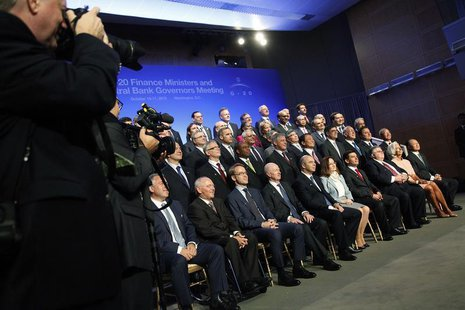 G20 finance ministers and central bank governors gather for a photo at the start of the annual International Monetary Fund and World Bank fa