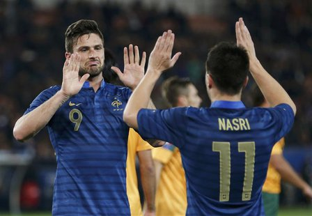 France's Olivier Giroud (L) celebrates with team mate France's Samir Nasri after he scored against Australia during their friendly soccer ma