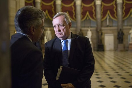 Nadeam Elshami, (L) chief of staff to House Minority Leader Nancy Pelosi (D-CA), speaks with U.S. Senator Dick Durbin (D-IL) after a late-ni