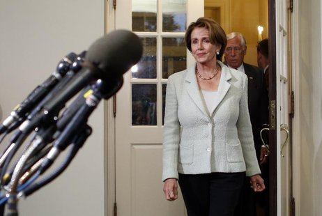 U.S. House Minority Leader Nancy Pelosi exits the White House to speak to reporters after a meeting between House of Representatives Democra
