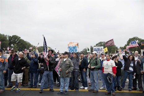 "Protesters with the ""Million Vet March on the Memorials"" rally in front of the National U.S. World War II Memorial in Washington October 13,"