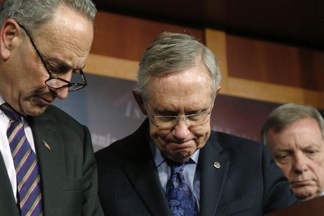(L-R) U.S. Senator Charles Schumer (D-NY), Senate Majority Leader Harry Reid (D-NV), and Senator Richard Durbin (D-IL) attend a news confere