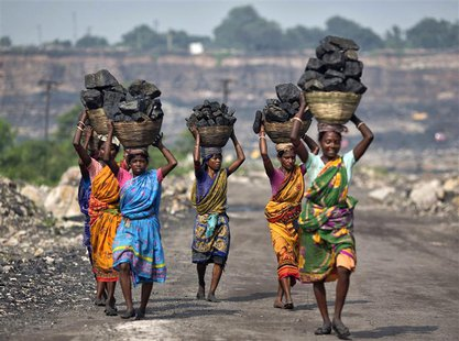 Local women carry coal taken from open cast coal field at Dhanbad district in the eastern Indian state of Jharkhand in this September 19, 20