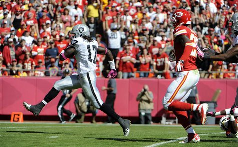 Oct 13, 2013; Kansas City, MO, USA; Oakland Raiders wide receiver Denarius Moore (17) scores a touchdown against the Kansas City Chiefs in t