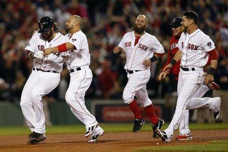 Oct 12, 2013; Boston, MA, USA; Boston Red Sox right fielder Shane Victorino (second from left) congratulates catcher Jarrod Saltalamacchia (