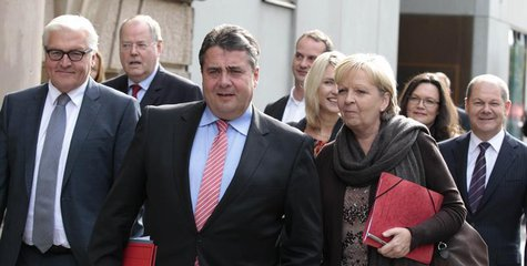 Social Democratic Party (SPD) party leader Sigmar Gabriel (C) arrives with SPD party fellows at the Parliamentary Society for preliminary ta