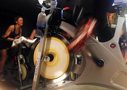 The wheels of an indoor bicycle are seen spinning at a SoulCycle class at their Union Square location in New York April 13, 2011. RREUTERS/S