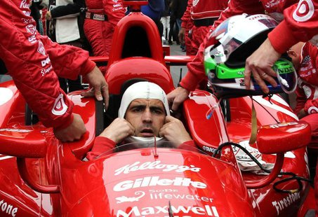 Target Chip Ganassi Racing driver Dario Franchitti of Britain dons his headgear ahead of the 97th running of the Indianapolis 500 at the Ind