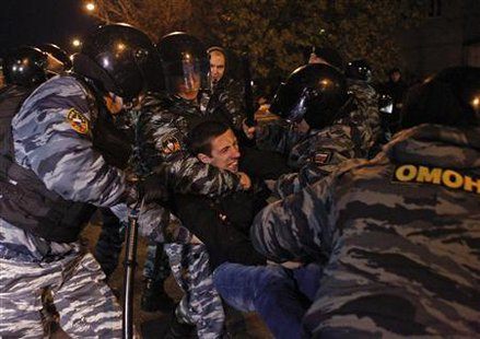 Russian police detain a man after a protest in the Biryulyovo district of Moscow October 13, 2013.  REUTERS/Maxim Shemetov