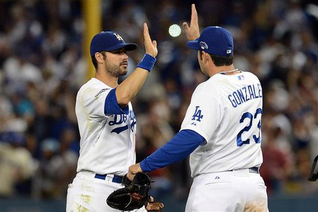 October 14, 2013; Los Angeles, CA, USA; Los Angeles Dodgers center fielder Andre Ethier (16) and first baseman Adrian Gonzalez (23) celebrat