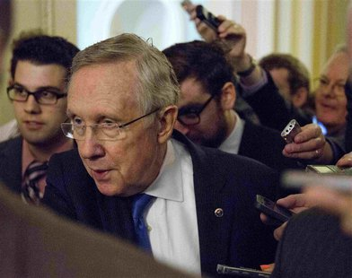 Senate Majority Leader Harry Reid (D-NV) speaks to reporters during the 14th day of the partial government shut down in Washington October 1