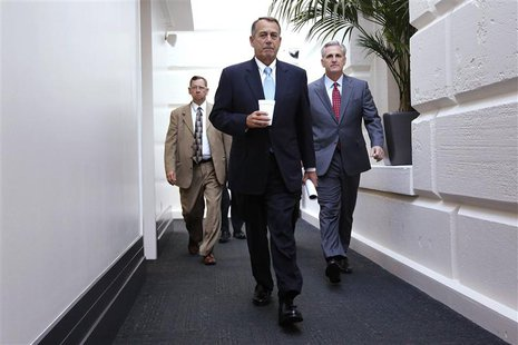 House Speaker John Boehner (R-OH) (C) and House Majority Whip Rep. Kevin McCarthy (R-CA) (R) arrive for a Republican caucus meeting at the U