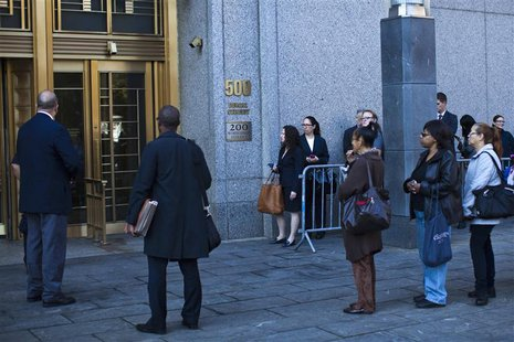 People wait in line to enter Manhattan's federal court where Nazih al-Ragye, known by the alias Abu Anas al-Liby, is expected for arraignmen