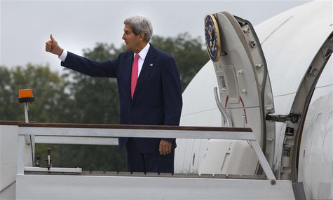 U.S. Secretary of State John Kerry gestures as he boards his aircraft to depart London October 14, 2013. REUTERS/Jacquelyn Martin/Pool