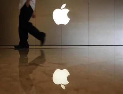 A man walks past the logo at an Apple store in the southern Chinese city of Shenzhen, neighbouring Hong Kong September 9, 2013. REUTERS/Bobb