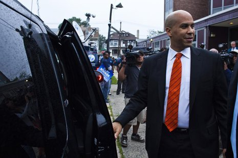 Newark Mayor and U.S. Senate candidate Cory Booker leaves a polling center after casting his ballot during the Senate primary election in Ne