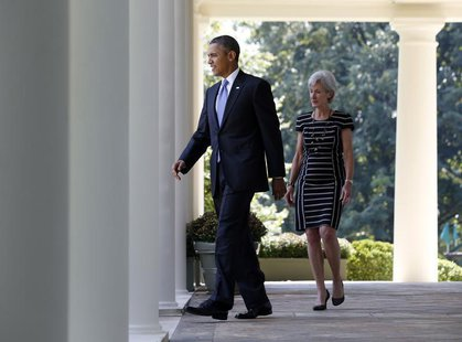U.S. President Barack Obama and Health and Human Services Secretary Kathleen Sebelius walk from the Oval Office to the Rose Garden of the Wh
