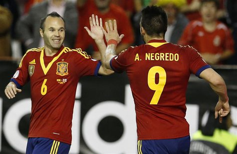 Spain's Alvaro Negredo (R) celebrates his goal with his teammate Andres Iniesta during their 2014 World Cup qualifying soccer match against