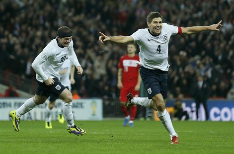 England captain Steven Gerrard (R) celebrates his goal with teammate Wayne Rooney during their 2014 World Cup qualifying soccer match agains