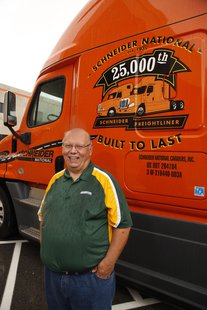 Schneider National's 25,000th Freightliner truck with driver Michael Darras. (Photo by: Schneider National).