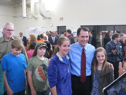Gov. Scott Walker poses with students at MSTC during the Heavy Metal Bus Tour