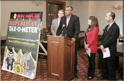 House democrats introduce the Taz-o-meter at a news conference in the State Capitol.