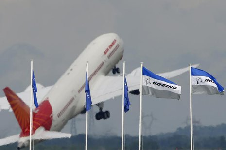 An Air India Boeing 787 Dreamliner prepares for a flying display, during the 50th Paris Air Show, at the Le Bourget airport near Paris, June