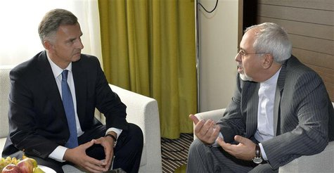Swiss Foreign Minister Didier Burkhalter (L) talks to Iranian Foreign Minister Mohammad Javad Zarif during a private meeting before the star