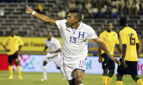 Honduras' Carlos Costly celebrates after scoring a goal against Jamaica in their 2014 World Cup qualifying soccer match in Kingston, October