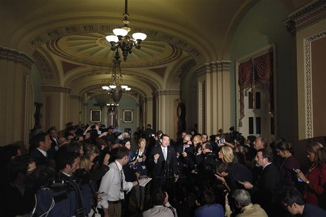 Reporters gather around U.S. Senator Ted Cruz (R-TX) as he announces he will not filibuster, after a Republican Senate caucus meeting at the