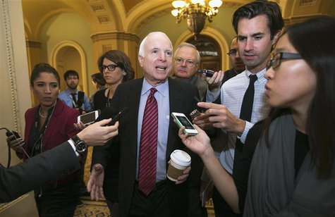 Senator John McCain (R-AZ) talks to reporters in the U.S. Capitol in Washington October 16, 2013. REUTERS/Kevin Lamarque