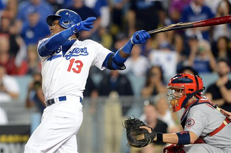 October 14, 2013; Los Angeles, CA, USA; Los Angeles Dodgers shortstop Hanley Ramirez (13) hits an RBI single in the eighth inning against th