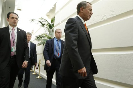 U.S. House Speaker John Boehner (R-OH) (R) arrives with his security detail for a House Republican caucus meeting at the U.S. Capitol in Was