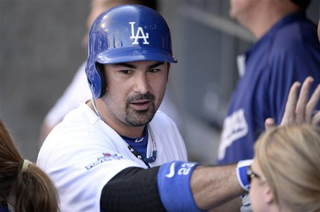October 16, 2013; Los Angeles, CA, USA; Los Angeles Dodgers first baseman Adrian Gonzalez (23) reacts after hitting a solo home run in the e
