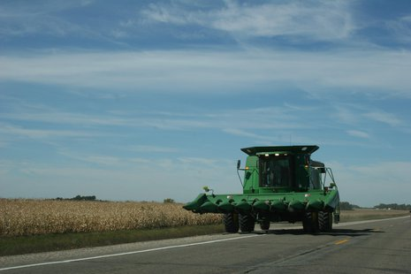combine on road file photo