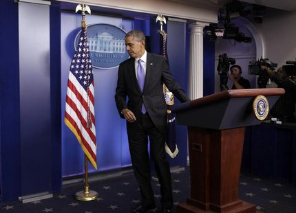 U.S. President Barack Obama leaves the briefing room of the White House in Washington after the Senate passed the bill to reopen the governm